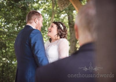 Bride and groom during woodland ceremony at Coppleridge Inn Wedding