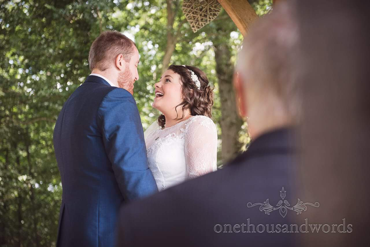 Bride and groom during woodland ceremony at Coppleridge Inn Wedding