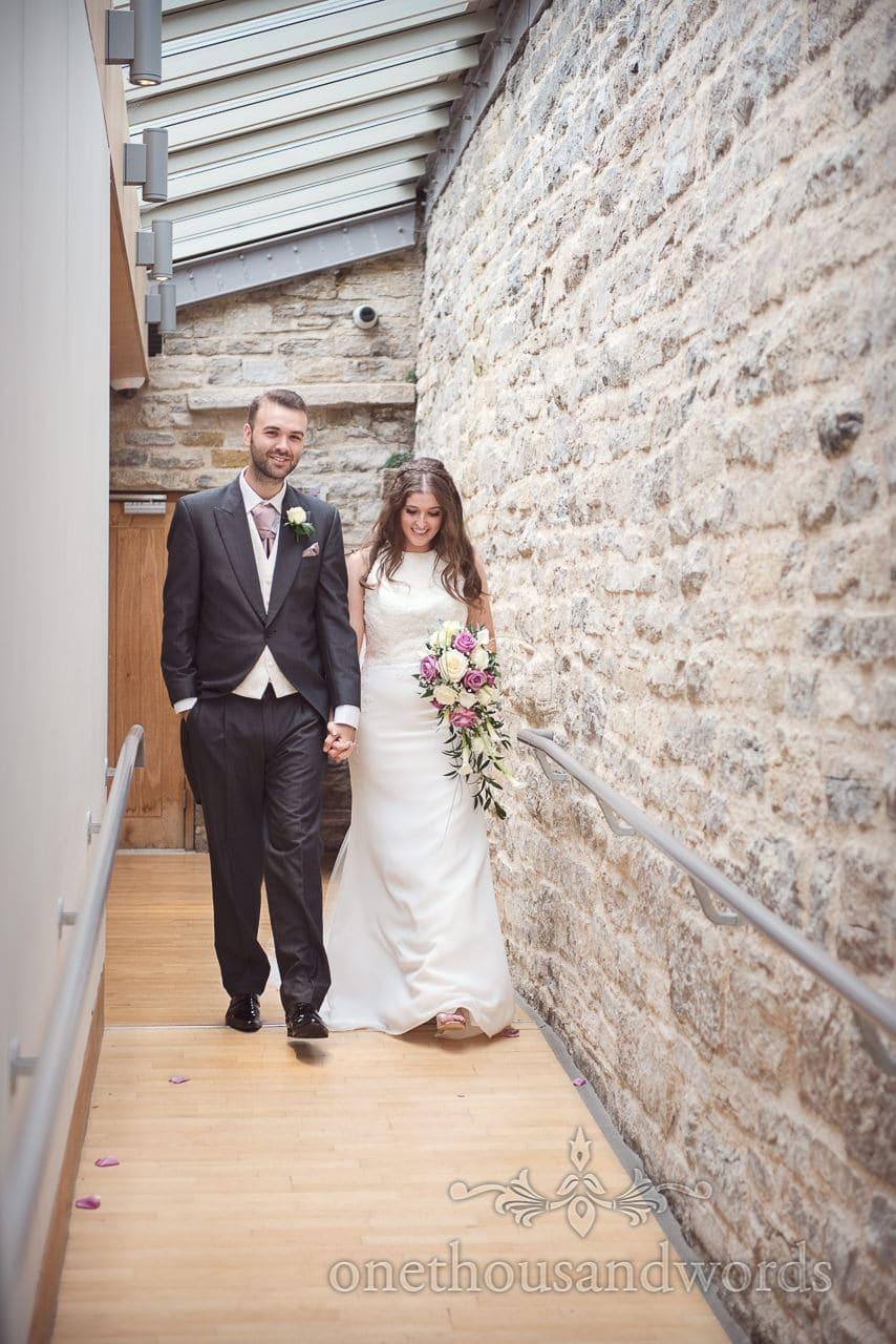 Bride and groom enter wedding breakfast at Durlston Castle Wedding Venue