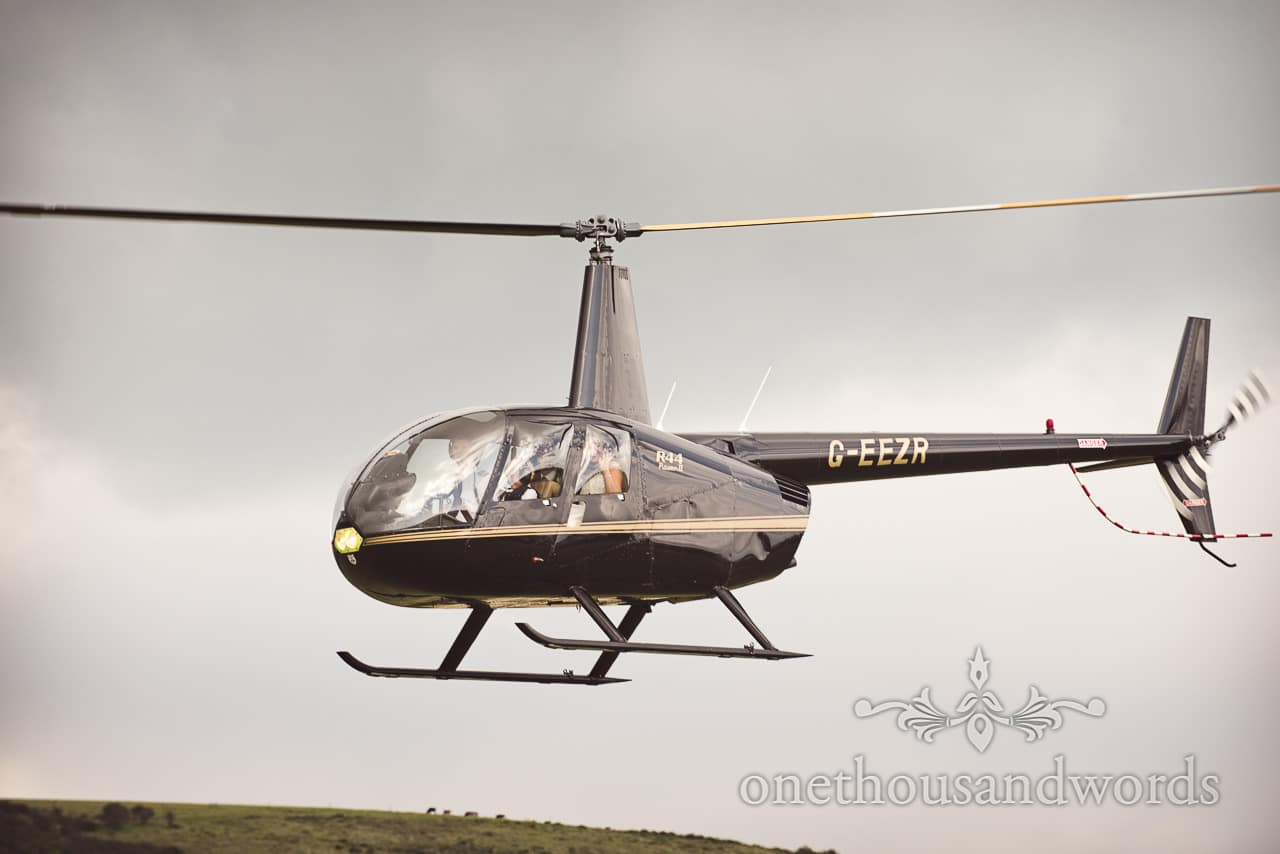 Bride and groom fly in helicopter to reception venue