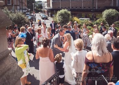 Bride and groom greet guests outside Bournemouth Church wedding Venue