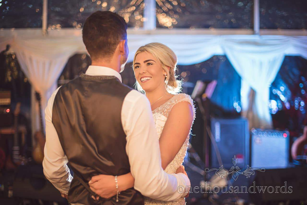 Bride and groom perform their first dance at Purbeck Valley Farm wedding photographs