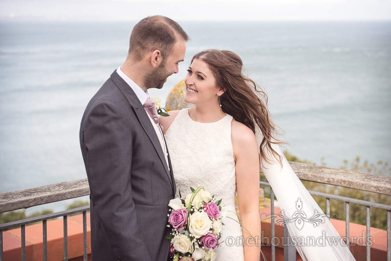 Bride and groom portrait photograph by the sea at Durlston Castle Wedding