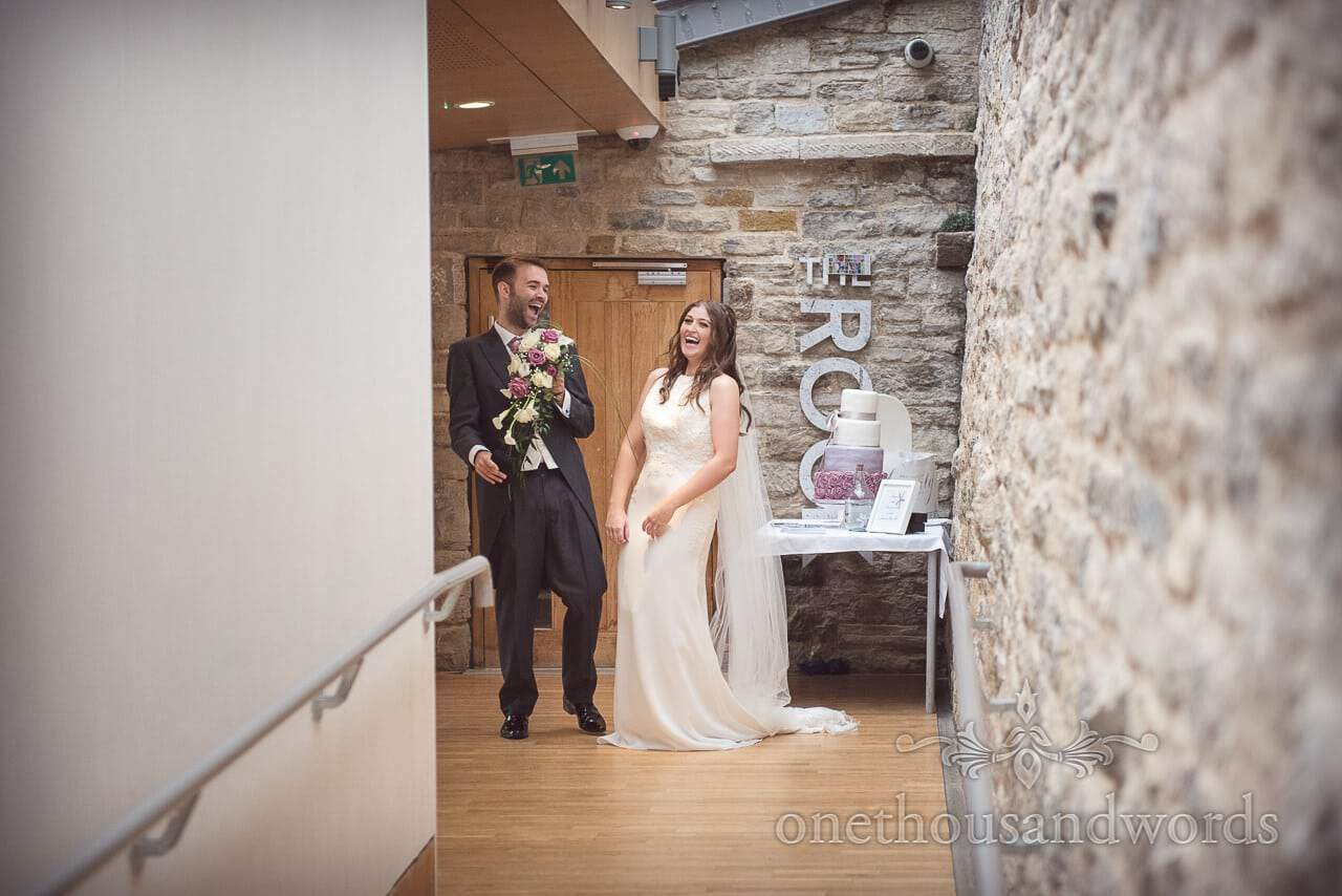 Bride and groom share a hilarious moment together at Durlston Castle Wedding Venue