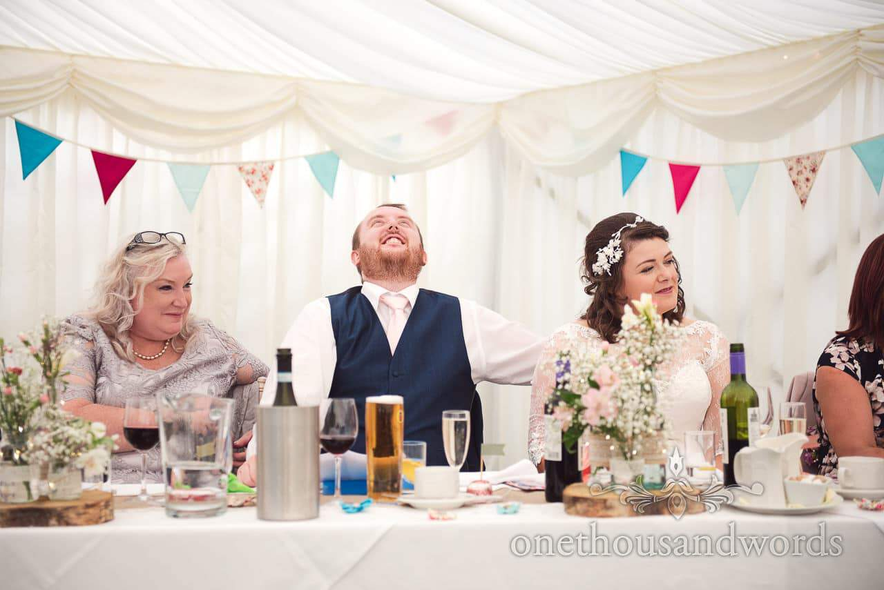 Bride, groom and mother during best men speech at Coppleridge Inn Wedding Photographs