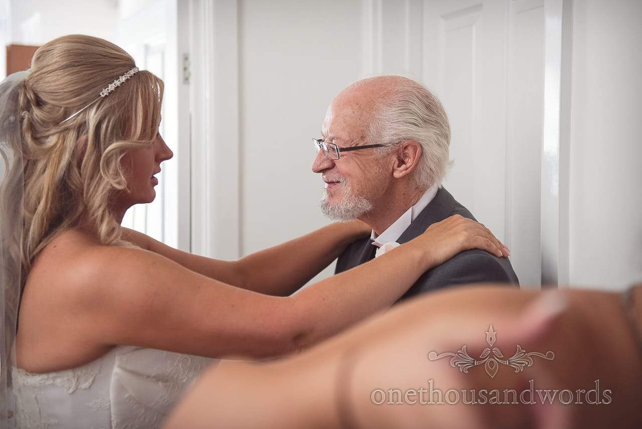 Bride has emotional moment with father of the bride before leaving for wedding