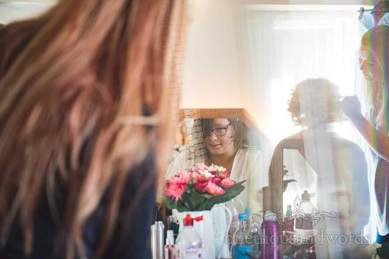 Bride has hair styled on morning of Coppleridge Inn Wedding Photographs