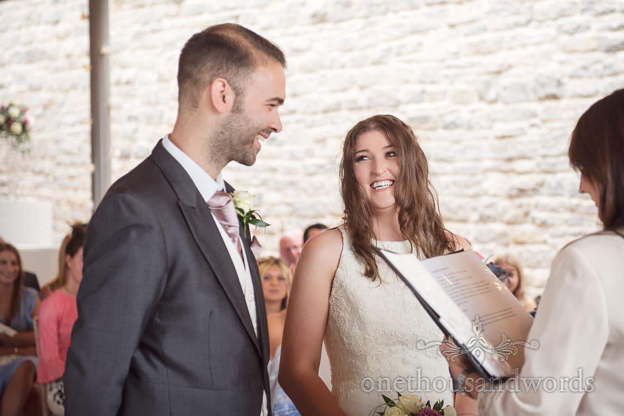 Bride laughs at groom during Durlston Castle Wedding ceremony photographs