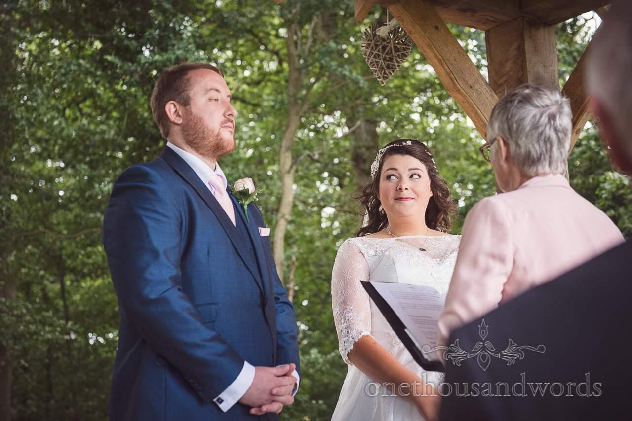 Bride looks at groom during woodland ceremony at Coppleridge Inn
