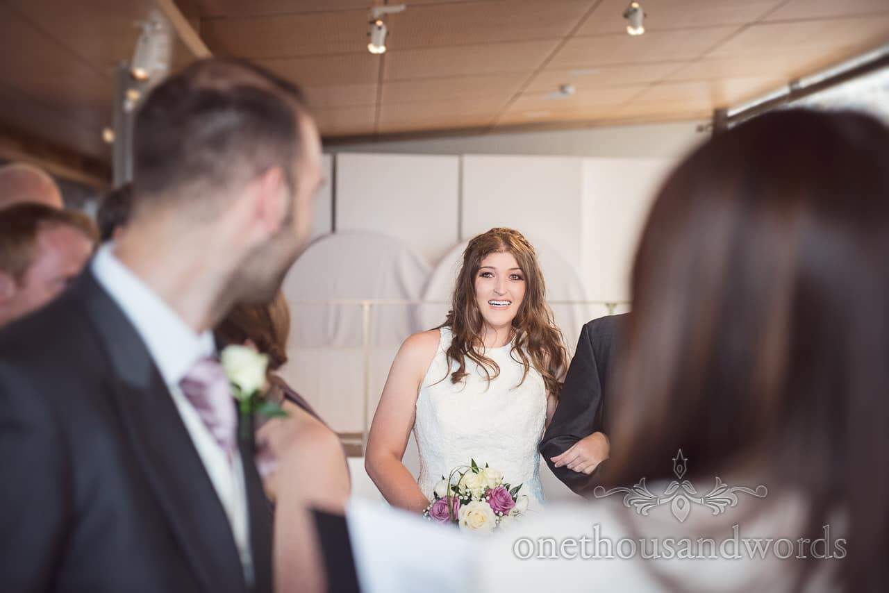 Bride's first look at groom as she comes down the aisle at Durlston Castle Wedding