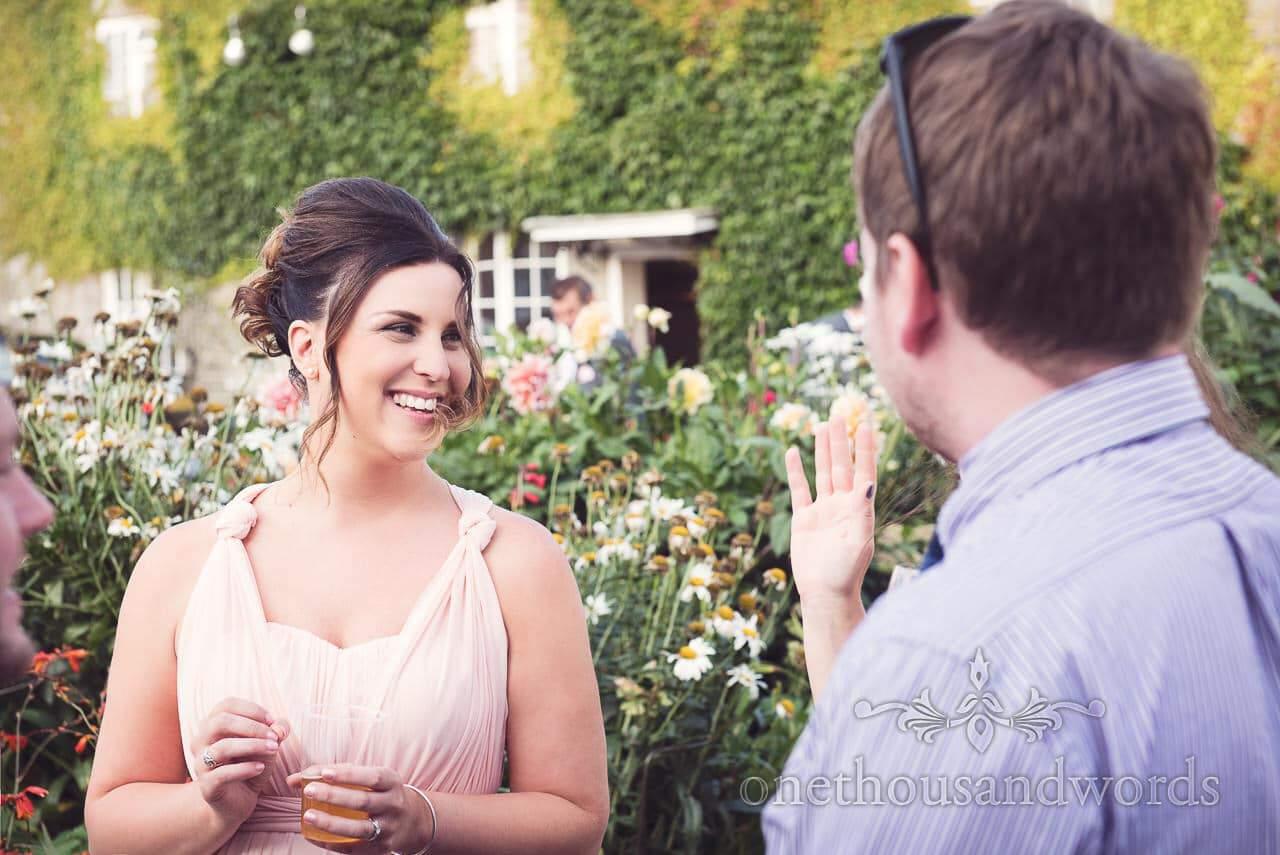Bridesmaid and guests in garden at Coppleridge Inn Wedding Photographs