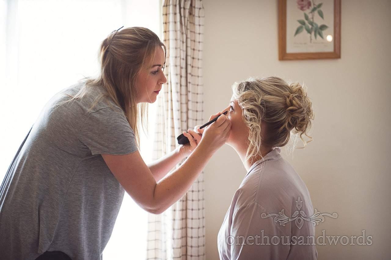 Bridesmaid and make up artist on morning of Coppleridge Inn Wedding