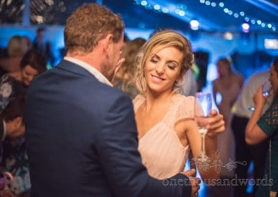 Bridesmaid dancing with guest at Purbeck Valley Farm Wedding Photographs