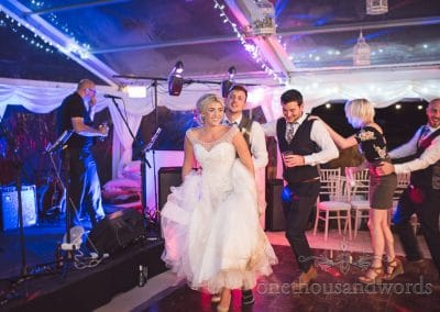 Conga line during reception at Purbeck Valley Farm wedding photographs