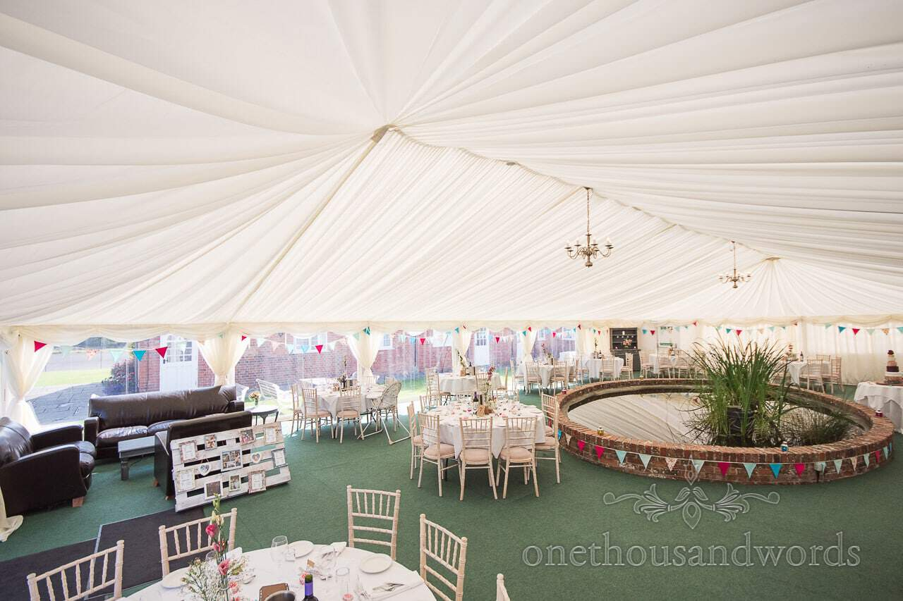 Decorated Courtyard marquee with pond at Coppleridge Inn Wedding Photographs