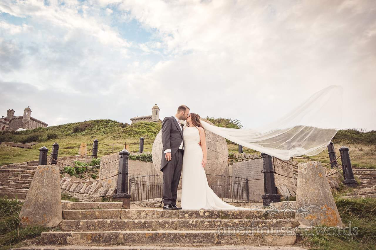 Durlston Castle Wedding Photographs by stone Victorian globe of bride and groom