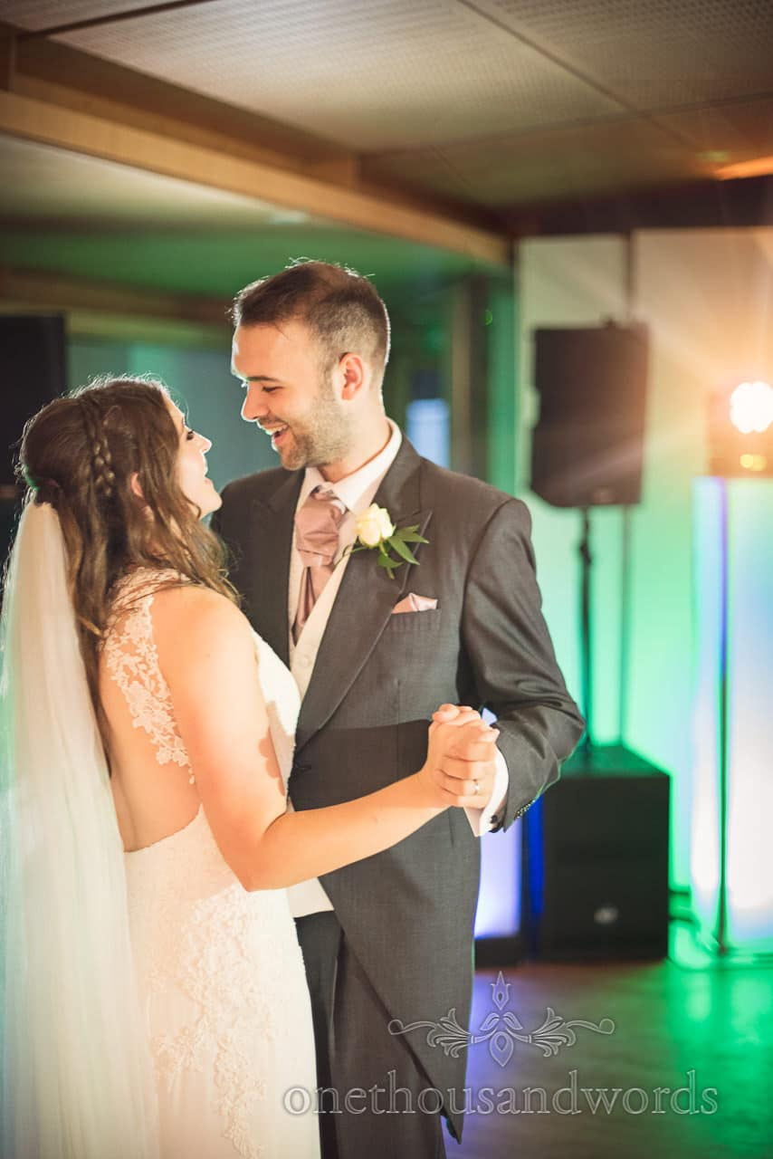 Durlston Castle Wedding Photographs of bride and groom laughing during first dance