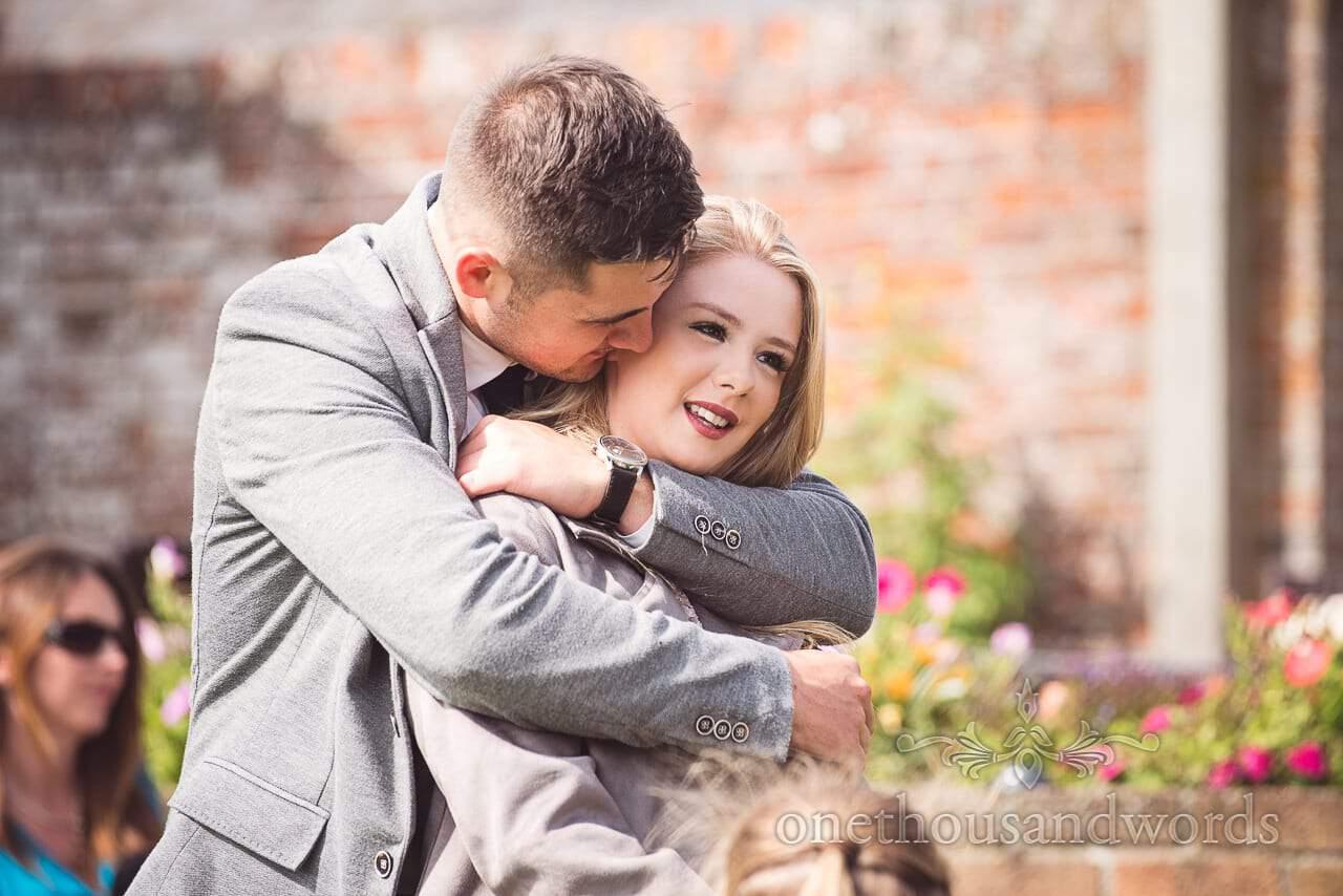 Embracing guest during drinks reception at Coppleridge Inn Wedding Photographs