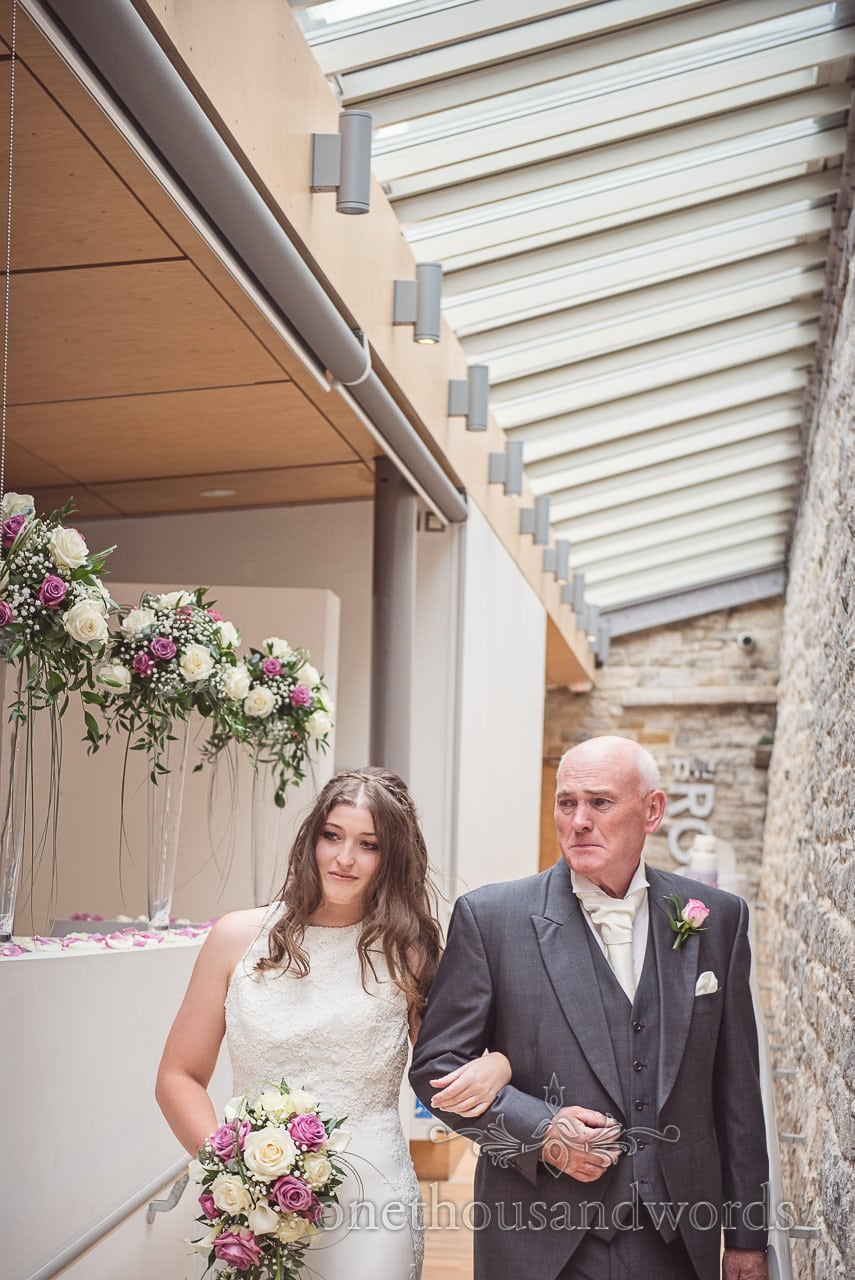 Father of bride cries as he walks bride down aisle at Durlston Castle Wedding