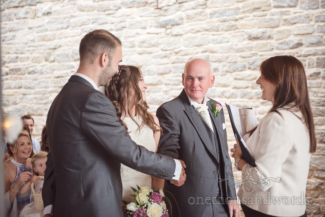 Father of bride shakes grooms hand during Durlston Castle Wedding ceremony