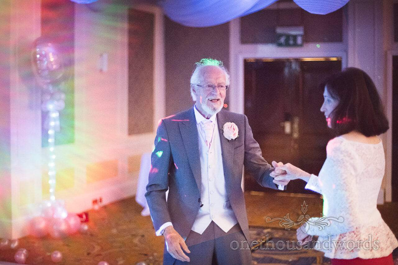 Father of the bride dances at Bournemouth Hotel wedding venue photograph