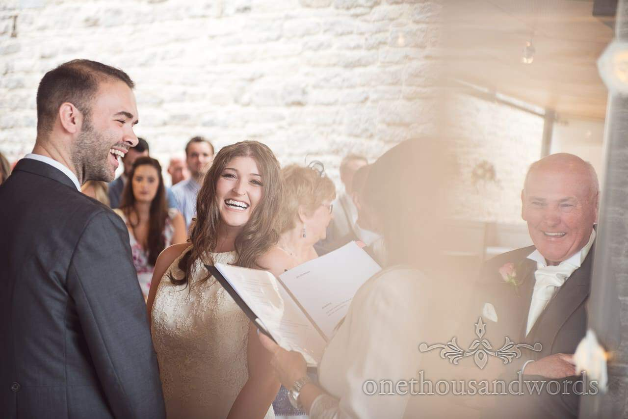 Father of the bride laughs during wedding ceremony at Durlston Castle Wedding