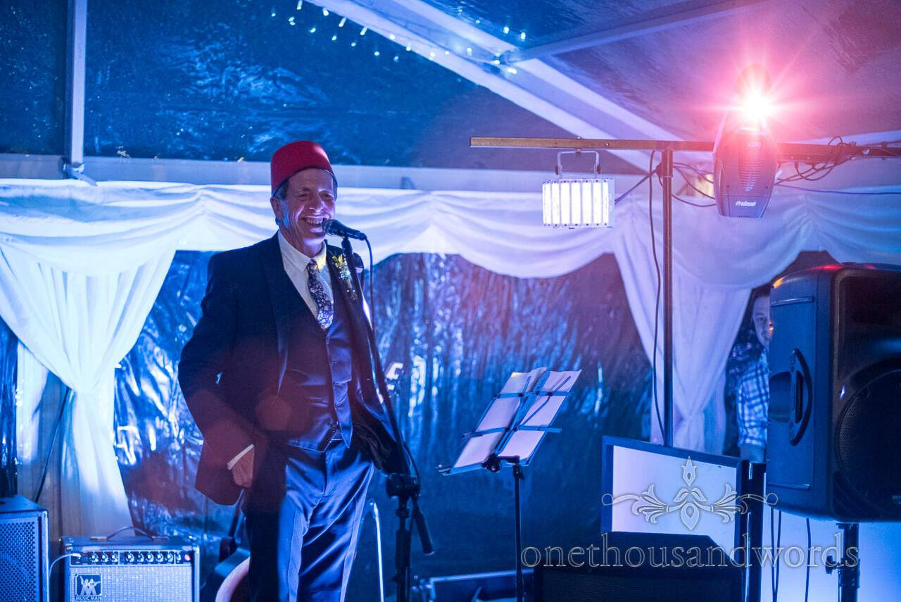 Father of the groom makes a speech at Purbeck Valley Farm wedding photographs