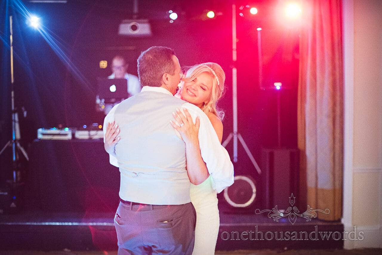 First dance with disco lights at Bournemouth Highcliff Marriott wedding venue