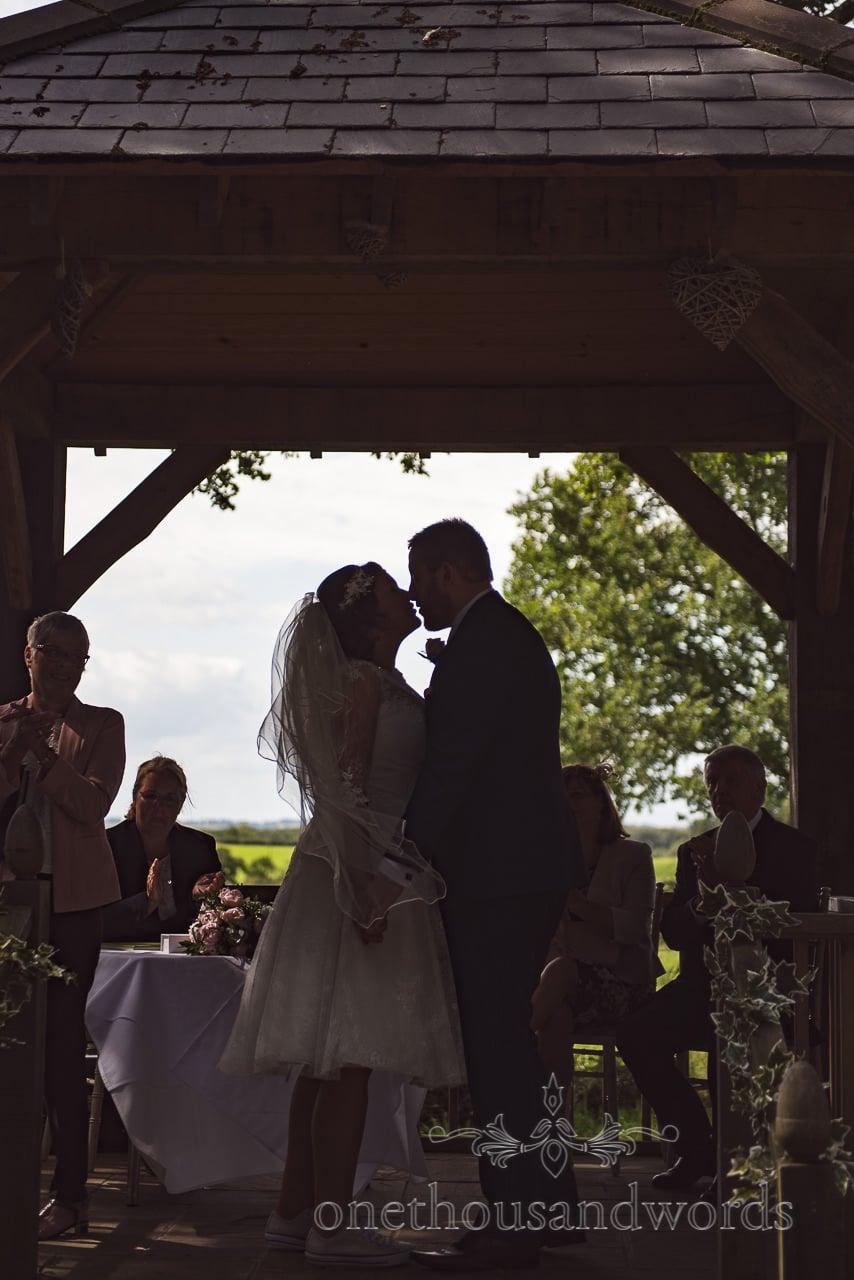 First kiss during woodland ceremony at Coppleridge Inn Wedding Photographs