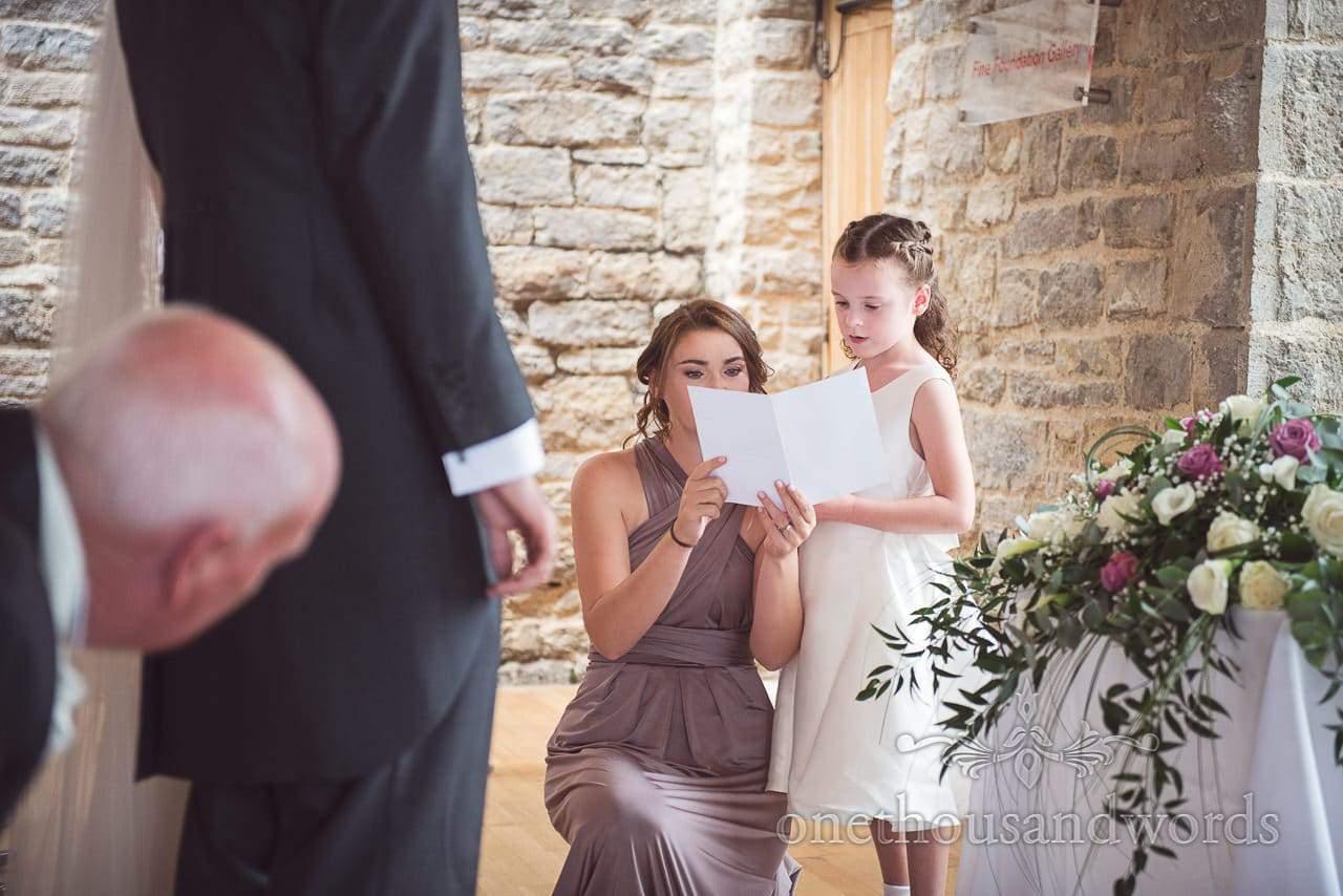 Flower girl makes reading at Durlston Castle Wedding ceremony in Dorset