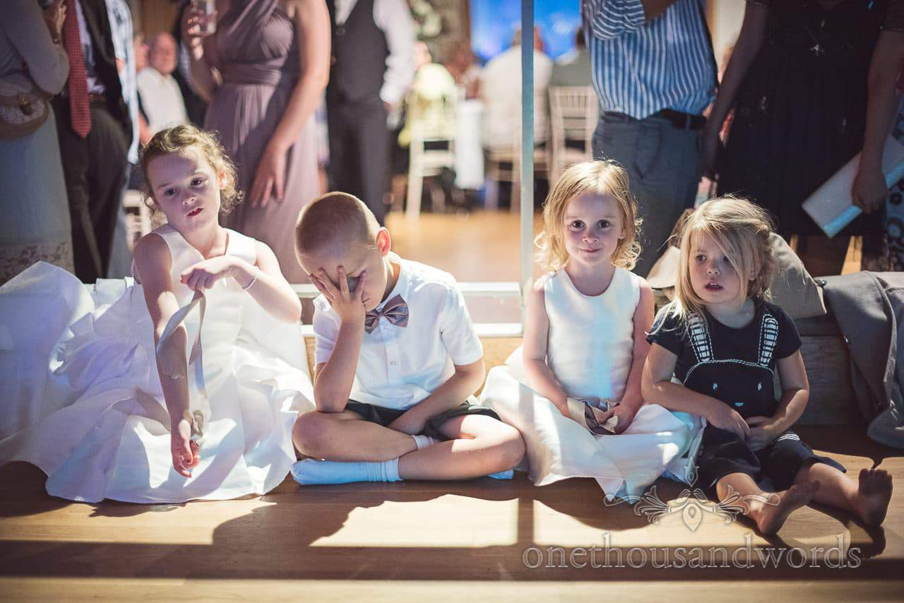Flower girls and page boy wait not so patiently for first dance at Durlston Castle wedding