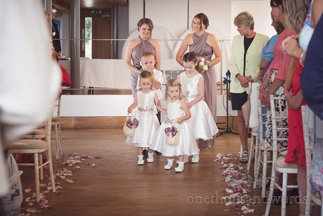 Flower girls sprinkle petals down aisle at Durlston Castle Wedding ceremony