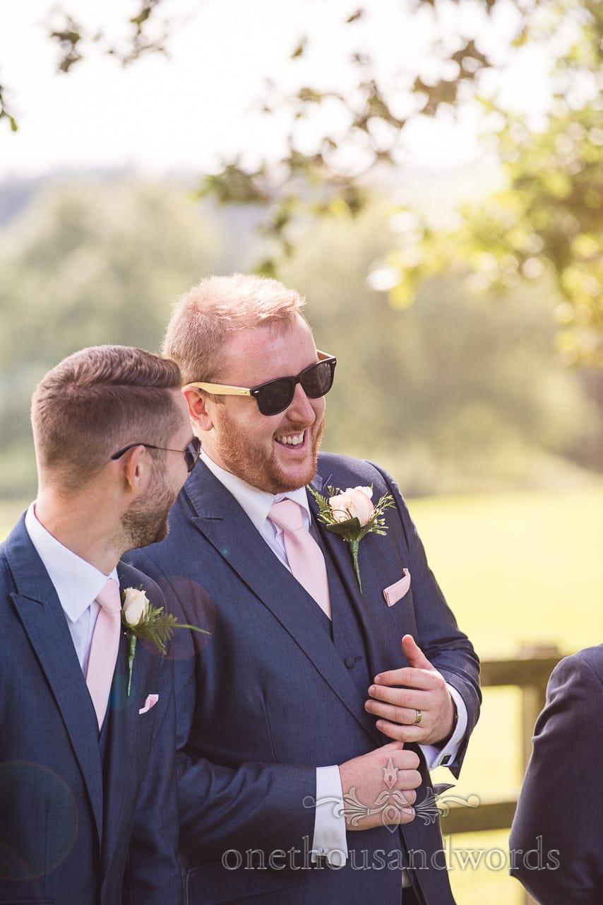 Groom and best man during group photographs at Coppleridge Inn Wedding Photographs