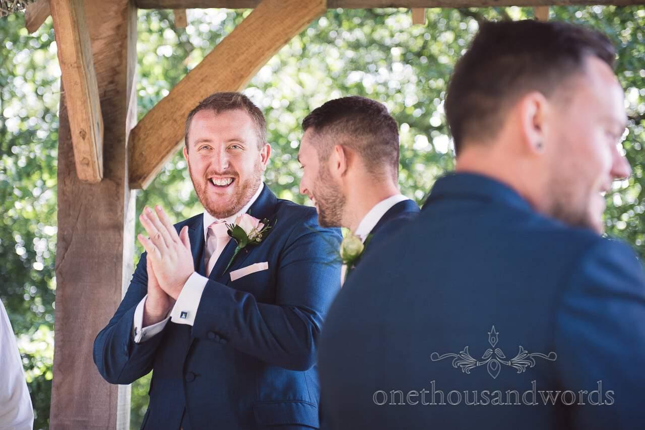 Groom and best man reaction at Coppleridge Inn woodland Wedding