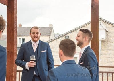 Groom and groomsmen enjoy a pre wedding drink before Coppleridge Inn Wedding
