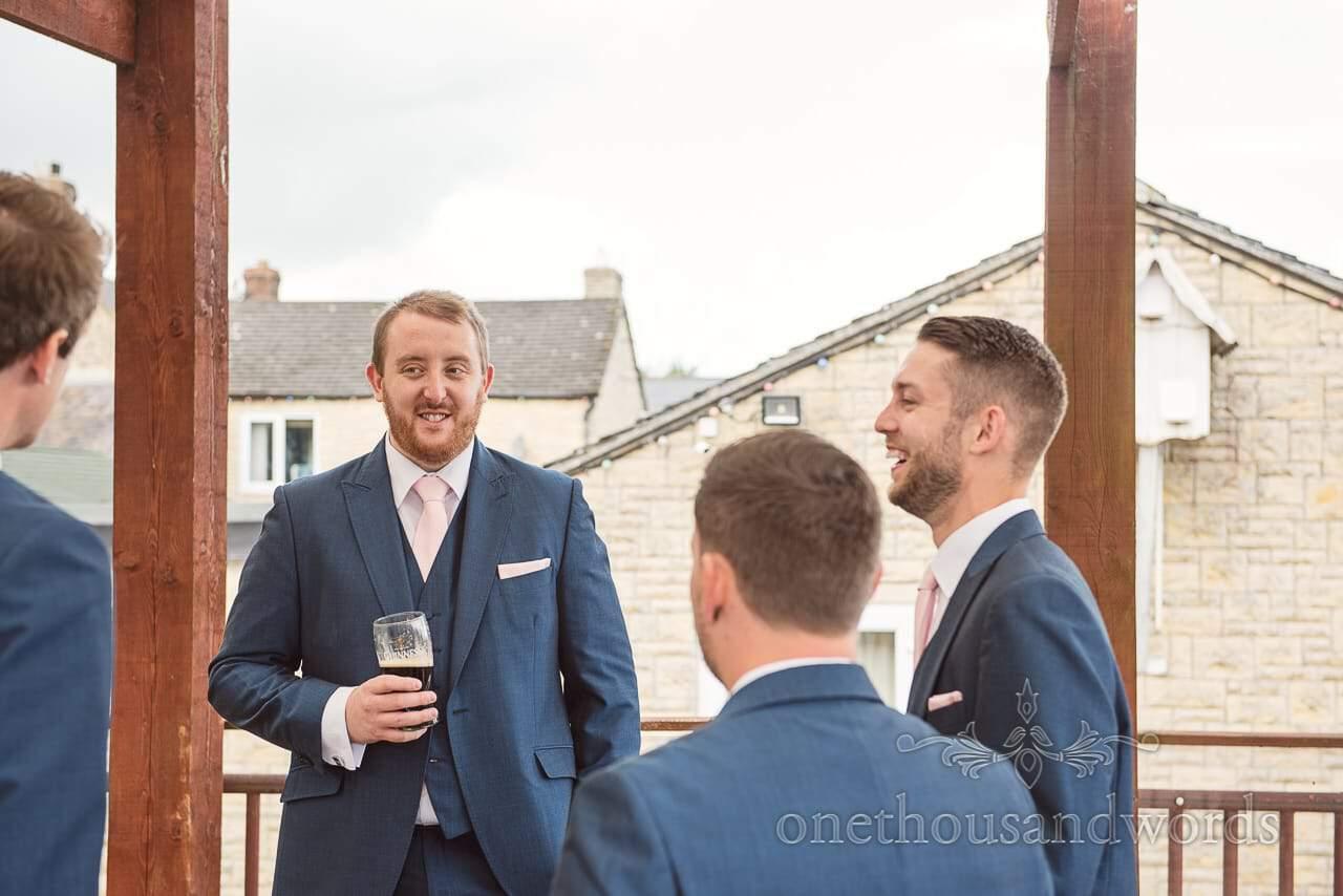Groom and groomsmen enjoy a pre wedding drink before Coppleridge Inn Wedding