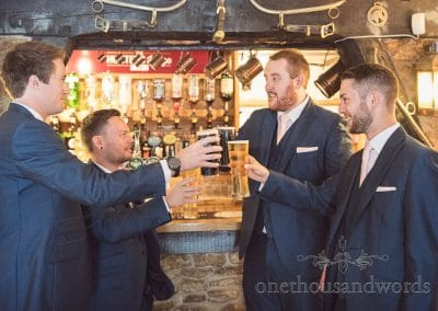 Groom and groomsmen raise a toast before Coppleridge Inn Wedding Photographs