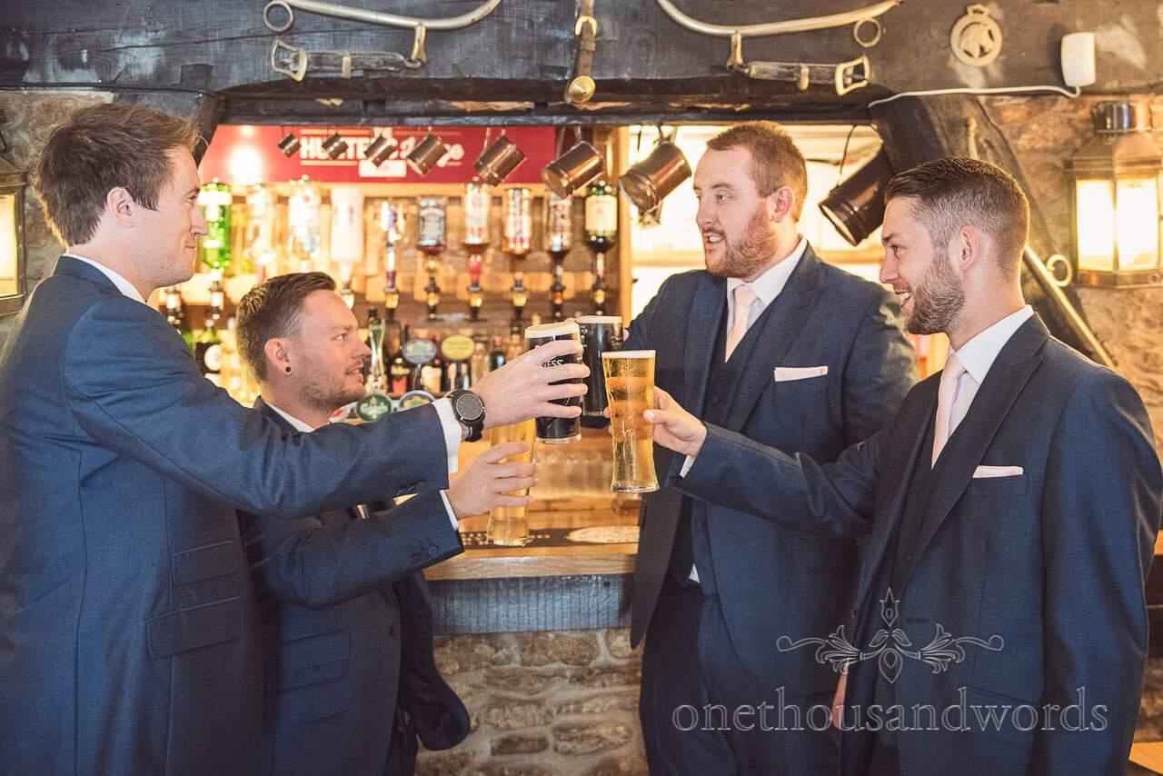 Groom and groomsmen raise a toast before Coppleridge Inn Wedding Photographs