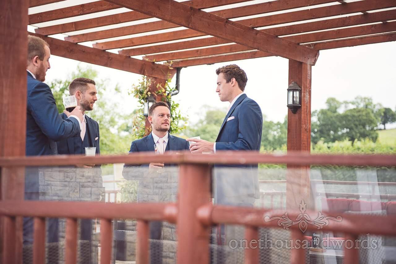 Groom and groomsmen relax in beer garden before Coppleridge Inn Wedding