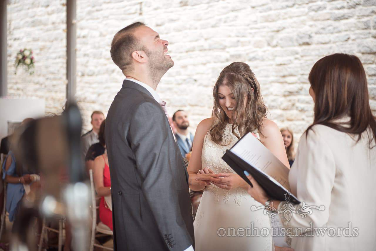 Groom creases up during Durlston Castle Wedding ceremony ring exchange