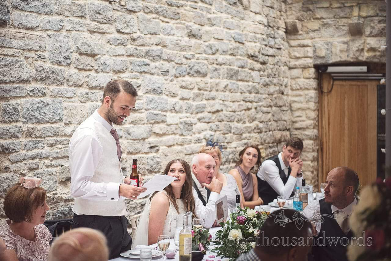 Groom delivers wedding speech with a beer at Durlston Castle Wedding venue