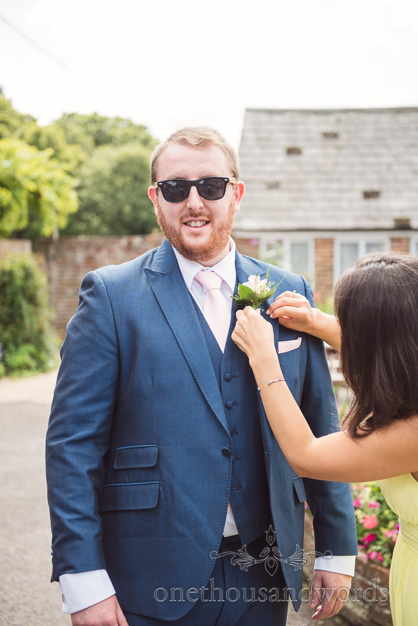 Groom has buttonhole positioned at Coppleridge Inn woodland Wedding