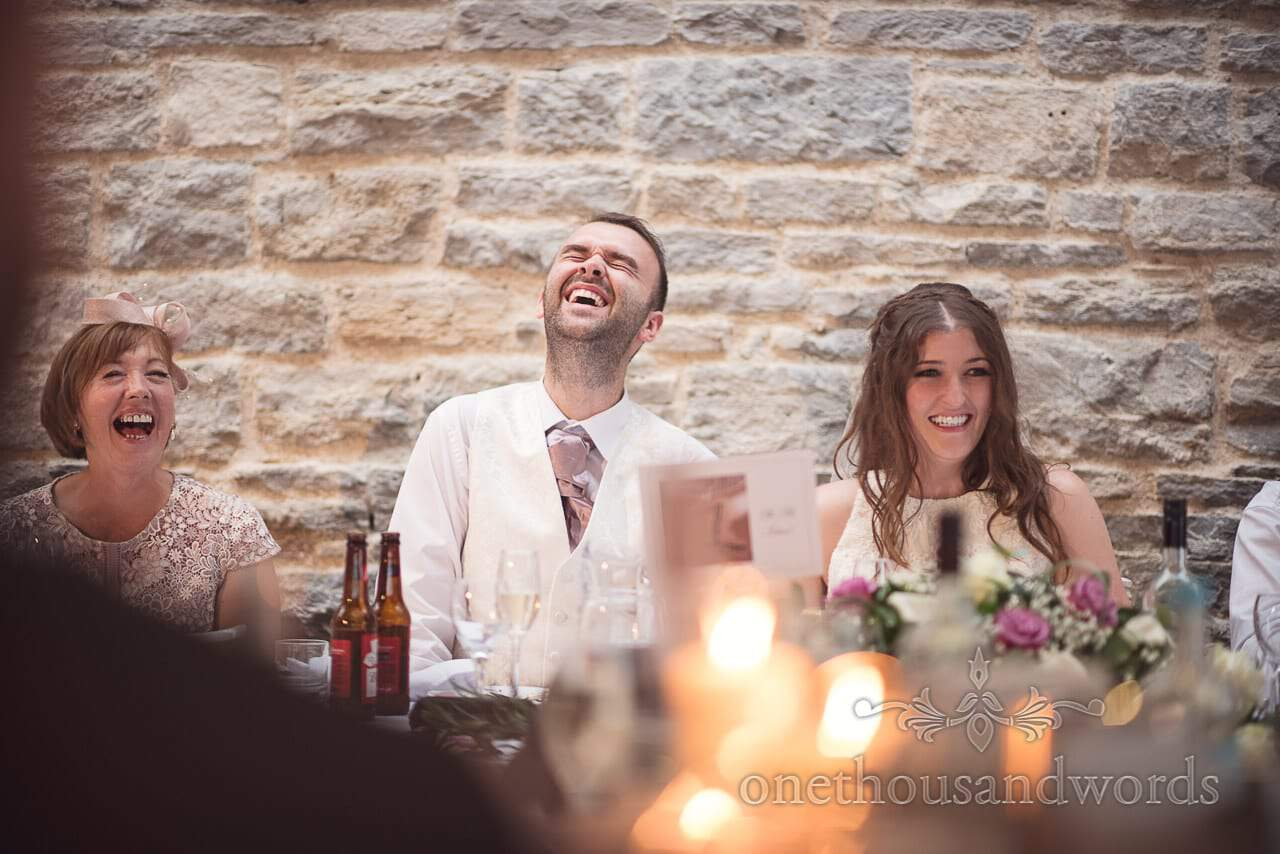 Groom laughing at wedding speeches at Durlston Castle Wedding venue in Dorset