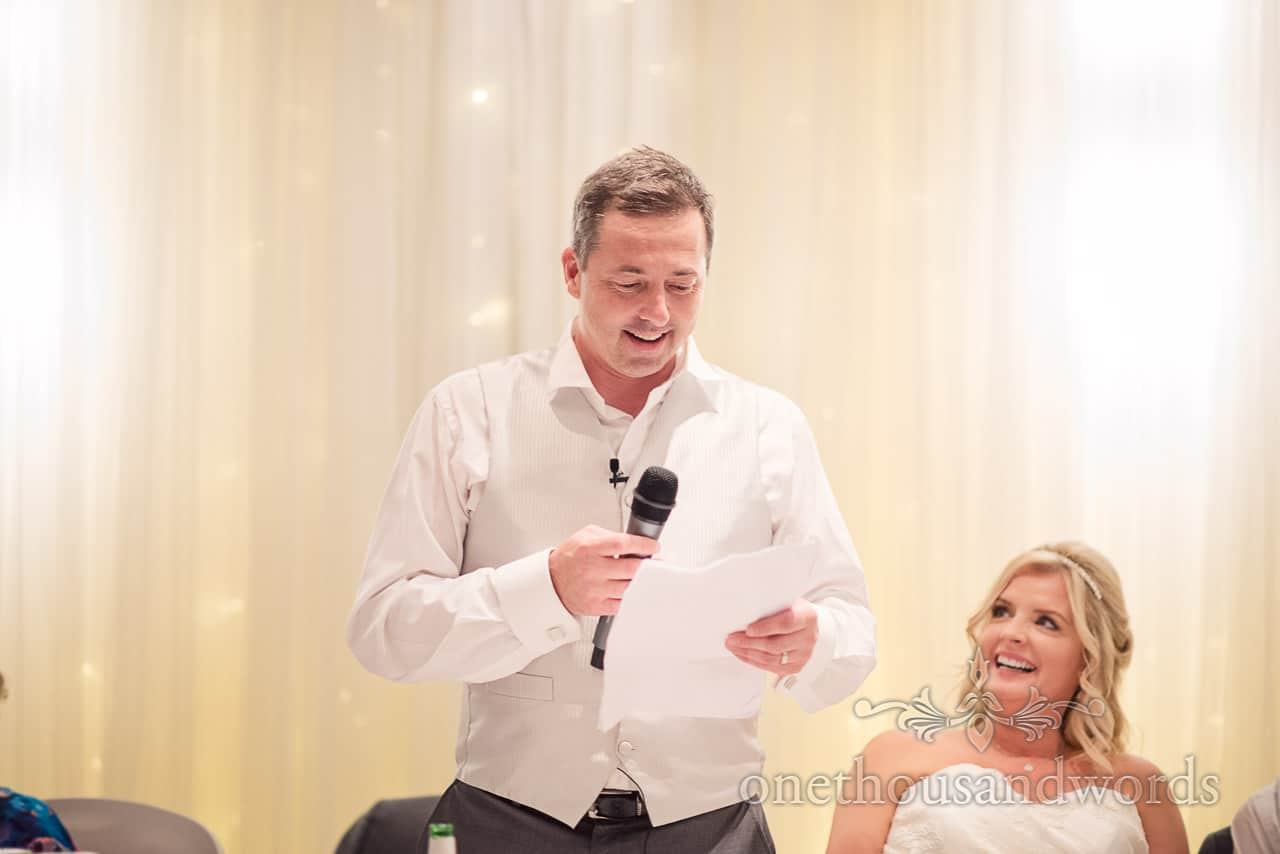 Groom makes wedding speech with microphone at Bournemouth Hotel Wedding