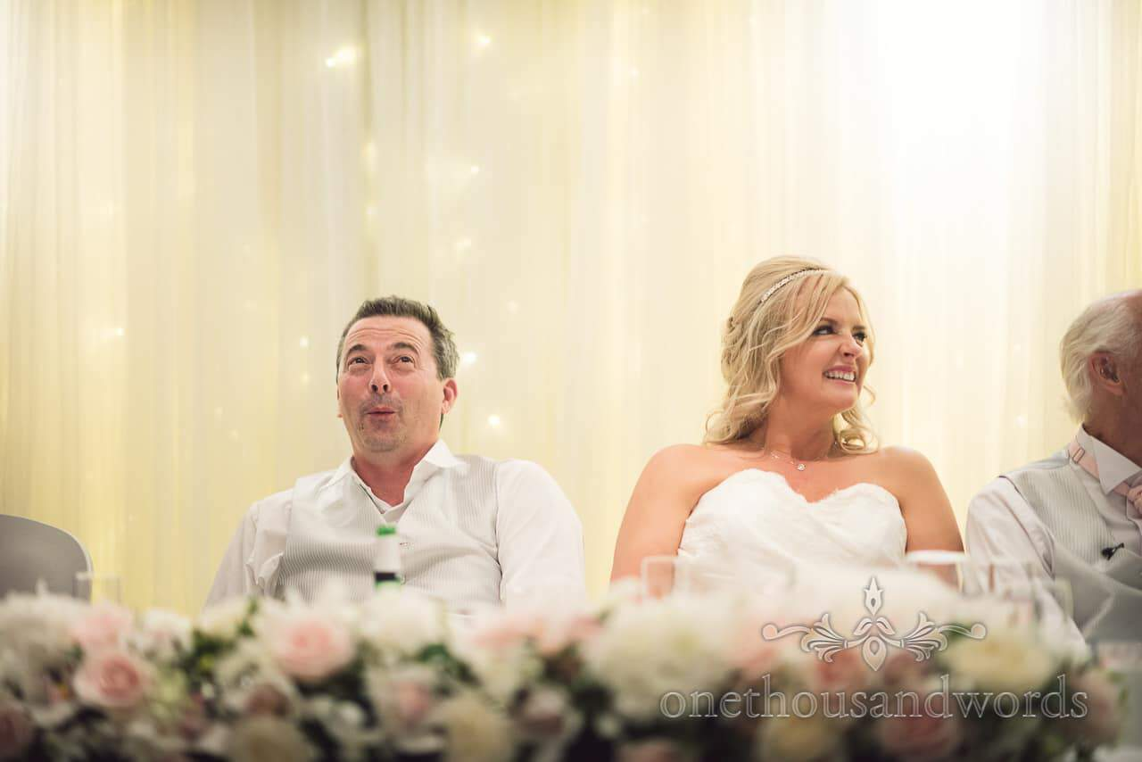 Groom pulls face reacting to best man's speech at Bournemouth Highcliff Marriott wedding