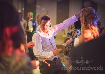 Groom pulls shapes dancing at Bournemouth Highcliff Marriott wedding photos
