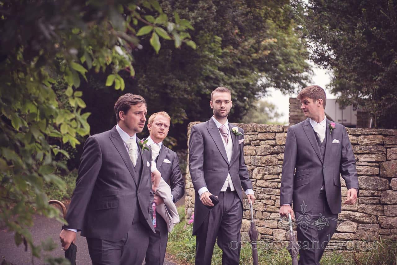 Grooms men looking cool in grey wedding suits at Durlston Castle Wedding