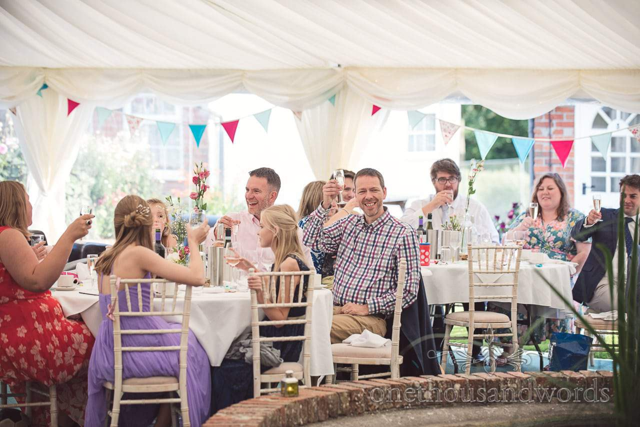 Guest raise a glass for toast at Coppleridge Inn Wedding Photographs