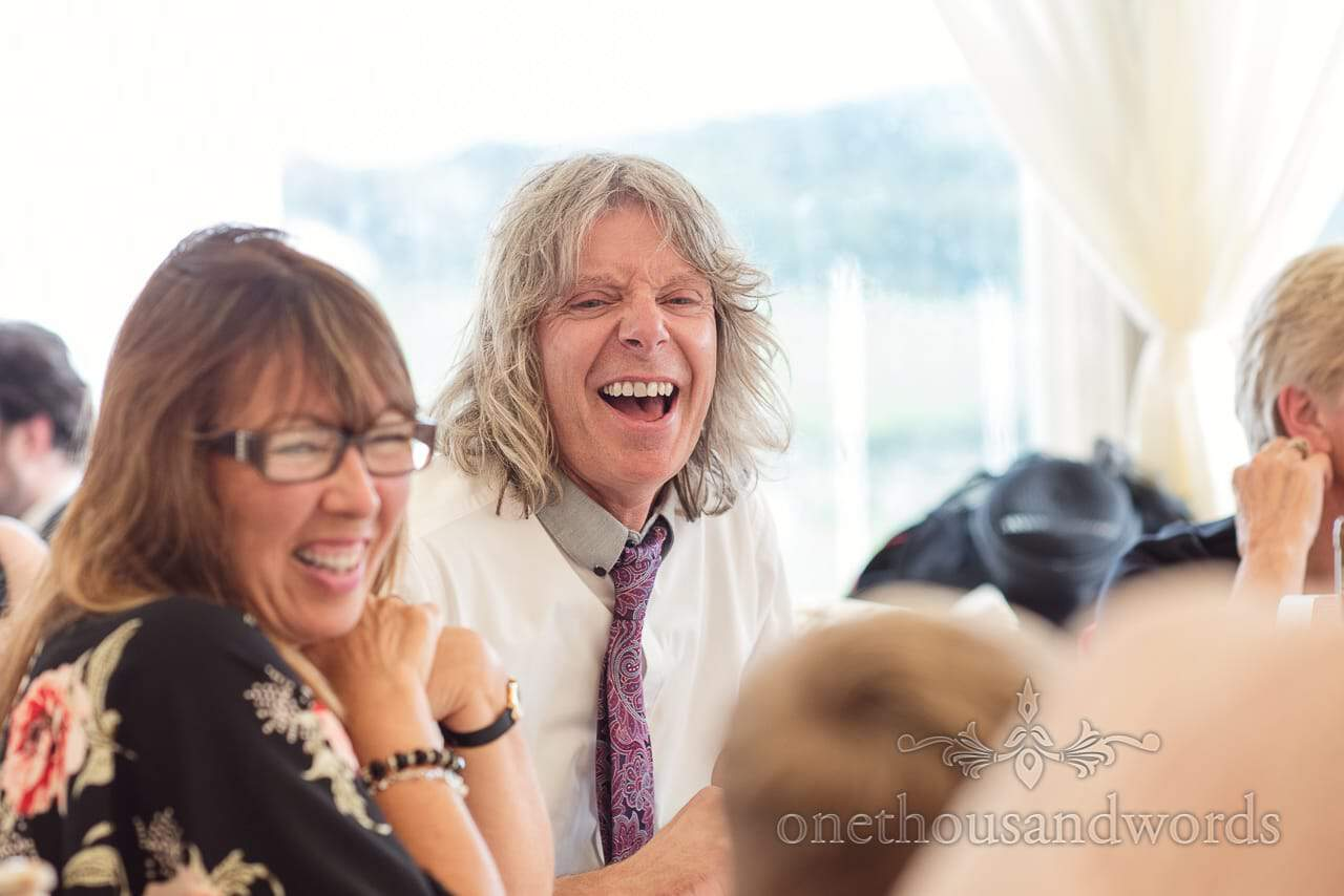 Guest reaction during speeches at Purbeck Valley Farm wedding photographs