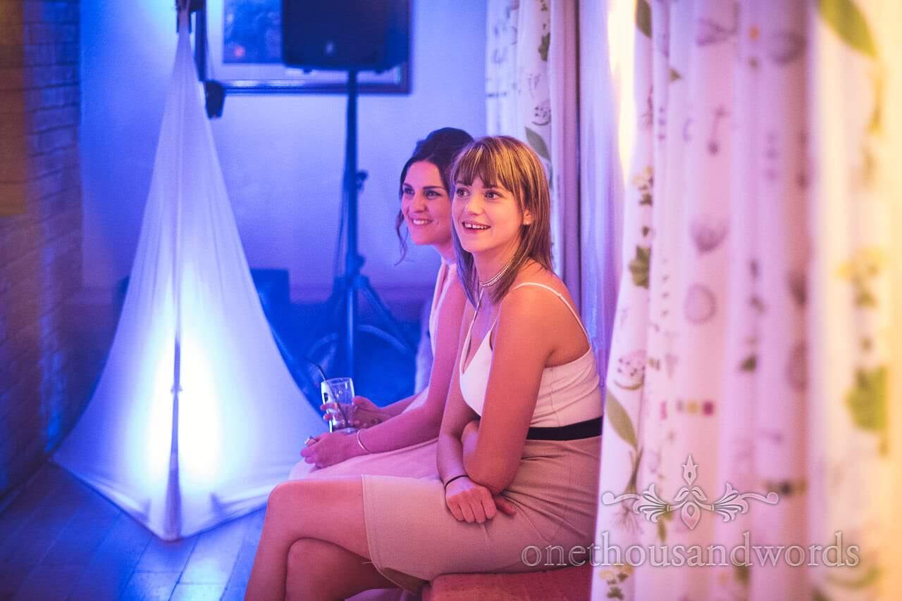 Guest take a break at side of dance floor at Coppleridge Inn Wedding Photographs